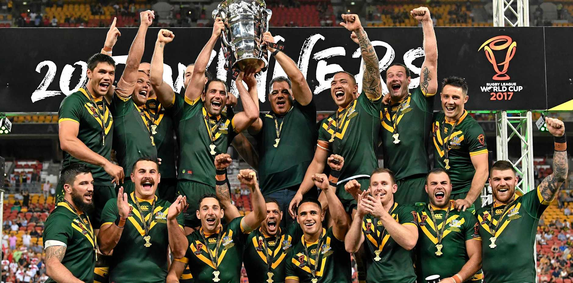 THE CHAMPIONS: Australia celebrates winning the Rugby League World Cup Final between the Australian Kangaroos and England played at Suncorp Stadium in Brisbane on Saturday.