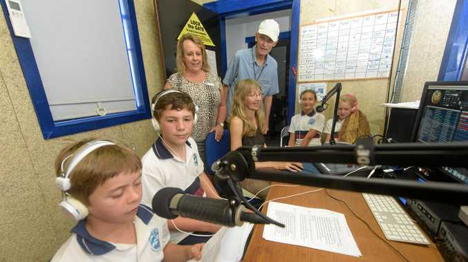 St James school students do their show on TLC 100.3 FM in Yamba, watched by TLC presenters and president Peter Finucan.
