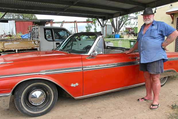 MINE: Roy Turner with his 1962 Ford Galaxie 500XL, which he's been slowly working on for about five years.