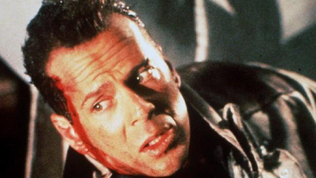 Actor Bruce Willis in scene from Christmas film 'Die Hard'.