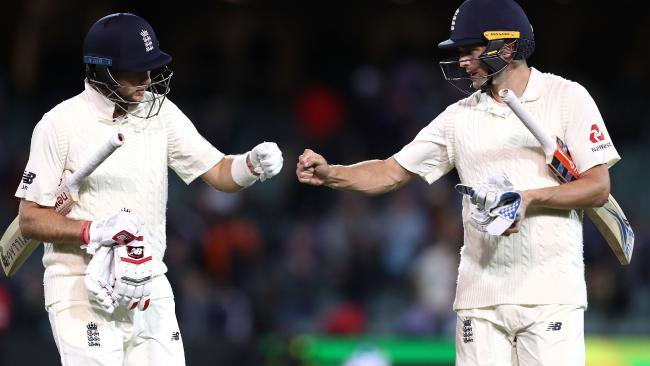 Chris Woakes and Joe Root leave Adelaide Oval at stumps.