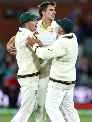 Pat Cummins celebrates Dawid Malan's wicket.