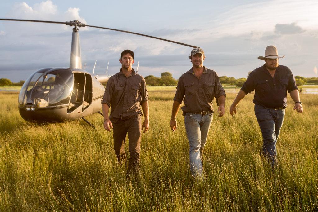 Crocodile relocator Matt Wright, centre, and his mates Jono and Willow return in season three of the TV series Outback Wrangler.