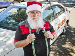 Santa cabbie a hit with customers
