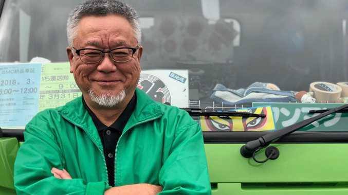 TOUGH STUFF: Driver AoYama Shinkichi and his brightly decorated Narrow Cab Fuso.