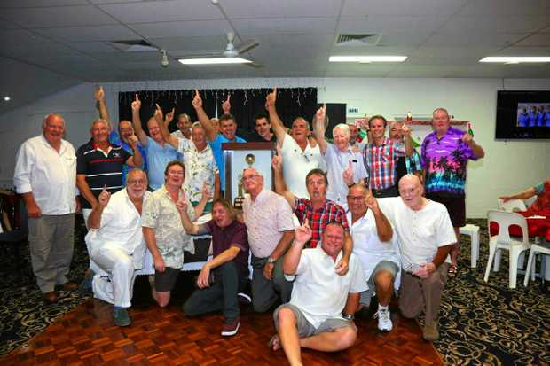SIMPLY THE BEST: The men bowlers of the Airlie Beach Bowls Club celebrate being the best club in the Mackay/ whitsunday division.