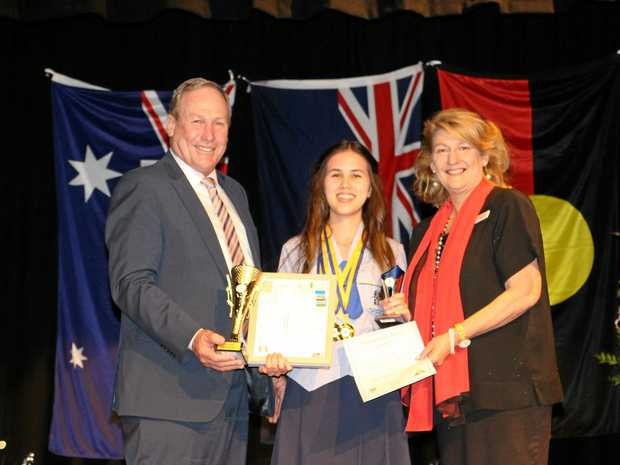 EXCELLENT WORK: Western Downs Mayor Paul McVeigh with Miles State High School Year 12 dux Brittany Gorry and principal Josette Moffatt.
