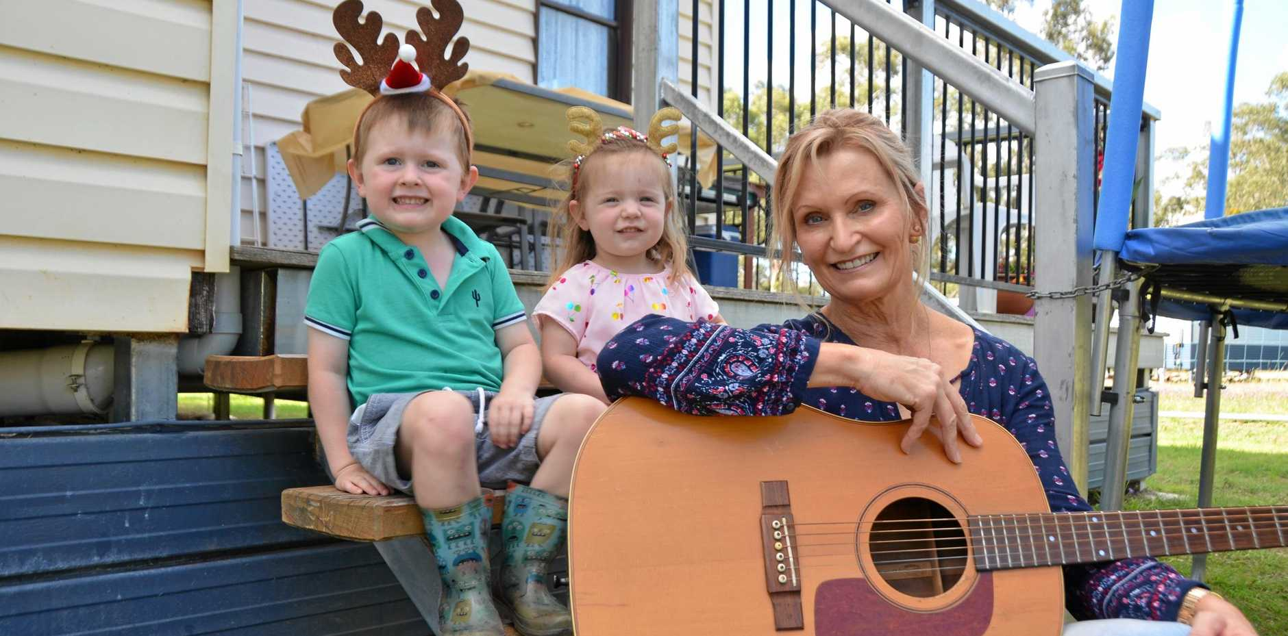 FAMILY'S IN TUNE: Warwick Carols in the Park musical director Erin Hilton and grandchildren Declan and Isla Ryan will all be attending the event on Sunday.