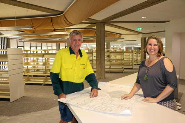 JM Kelly Builders Site Supervisor Peter Richardson and Richmond Tweed Regional Library Tweed Area Librarian Selina Ryan discuss the plans for the finishing touches to the upgraded Tweed Heads Library.