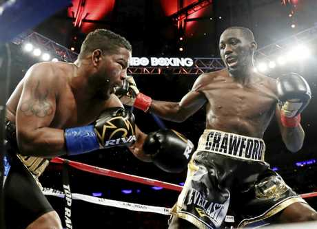 Terence Crawford (right) lands a blow during his lightweight championship fight against Felix Diaz.