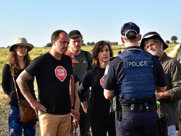 Greens MPs Dawn Walker and Jeremy Buckingham have been arrested after protesting against the Adani coal mine's rail construction.