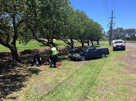 A man is being treated by paramedics after the crash.