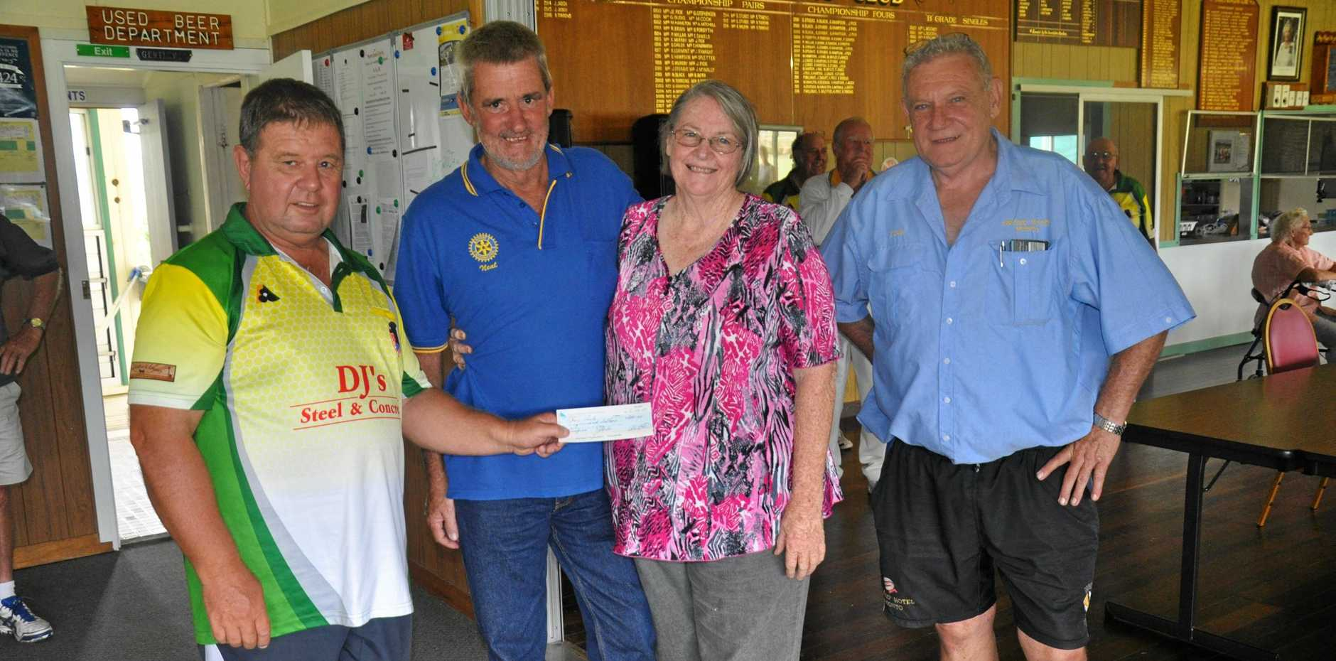 Kevin, Lyn Davis and Doug O'Sullivan present Neal Darlington of the Monto Rotary Club a cheque from the Jackpot Joker.