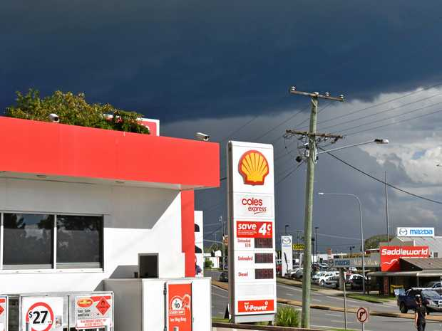 Brooding storm clouds loom over Monkland, contrasting with the bright sunshine at the Coles Shell Service Station on the Bruce Hwy at Gympie on Tuesday afternoon.