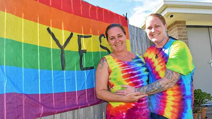 LOVE WINS: Carmel Bowkett and Cara Trollope outside their Hervey Bay home after hearing the news the majority of Australians who voted in the same-sex marriage postal survey voted Yes to same-sex marriage.