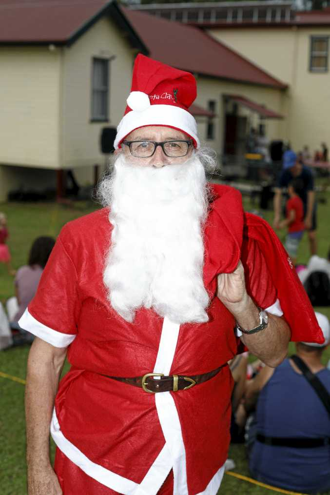 Santa had some treats for the kids at the Tyalgum Christmas Carols on Sunday, December 3.