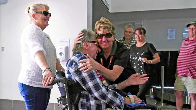 Sherry's sister Edna gives Wayne a hug as he enters the Roma Airport.