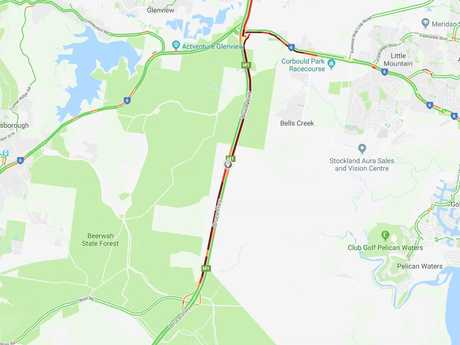 Traffic is affected in both directions after a ute rollover on the Bruce Hwy at Bells Creek.
