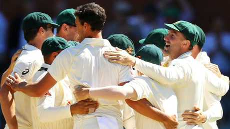 Australian players celebrate their win over England in the second Ashes Test in Adelaide on Wednesday.