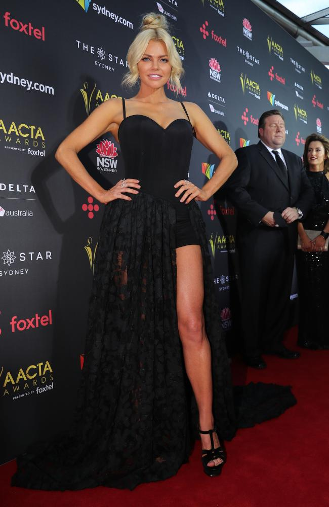 Sophie Monk arrives alone on the red carpet.