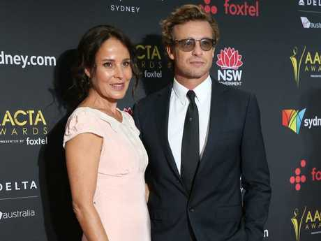 AACTA Trailblazer recipient Simon Baker arrives with his wife Rebecca Rigg. Picture: Richard Dobson