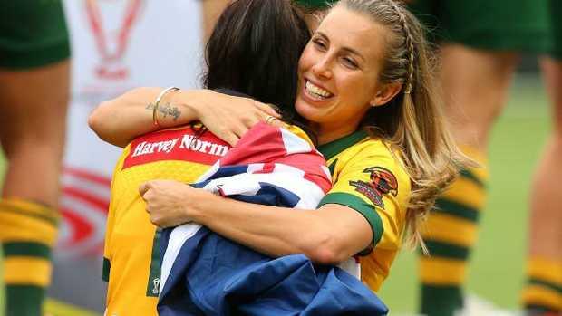 Sam Bremner hugs Nakia Davis-Welsh of the Jillaroos.