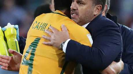 Socceroos coach Ange Postecoglou celebrates with Tim Cahill.