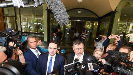 Former Nine Journalist Ben McCormack had a cup of water and spit thrown on him by a member of the public moments after leaving court. Picture: AAP /Peter Rae.