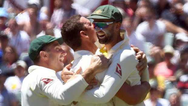 Australian paceman Josh Hazlewood (C) celebrates with teammates Shaun Marsh (L) and Nathan Lyon (R) after dismissing England captain Joe Root on Wednesday.