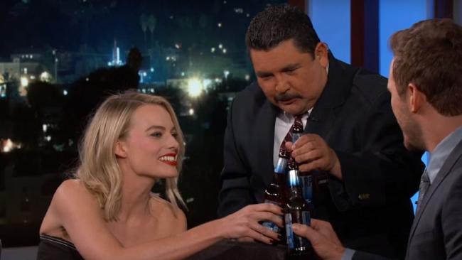 Cheers! Margot Robbie shows off her beer-busting skills.