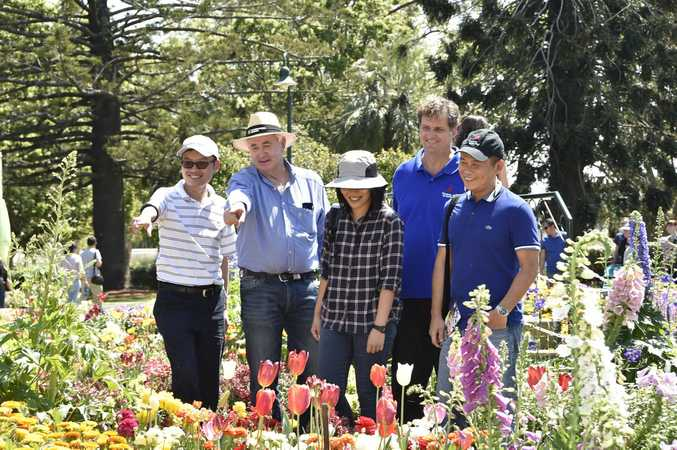INTERNATIONAL VISITORS: Singapore's Felix Loh joins Mayor Paul Antonio and Lee Ping Ping, Anton van der Shann and Boon Gee Ng Queens Park for a walk through the flowers during this year's Carnival of Flowers.