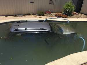 Car crashes into backyard pool at Darling Downs home