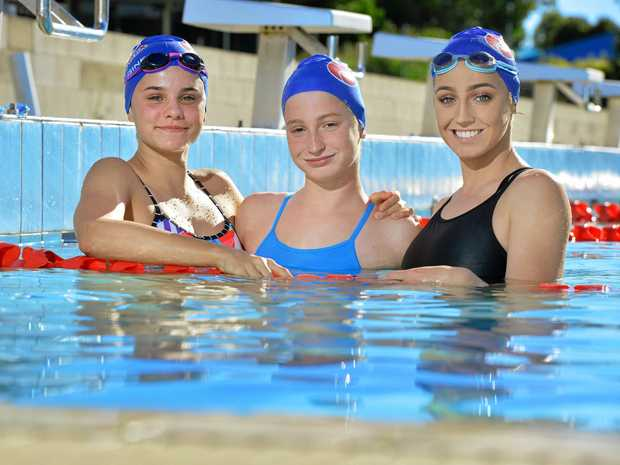 MAKING A SPLASH: Waterworx swimmers Jacinta Ticehurst, 14, Mollie O'Callaghan, 13, and Sophie O'Callaghan, 16 will go for gold at the State Swimming Championships.