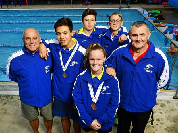 SWIM SQUAD: Woogaroo coach Noel Donnelly (left) with son Liam Donnelly, Joshua Dixon, Poppy Wilson, Sebastien Carvolth and coach Stephen Ballhause. Woogaroo will send 15 swimmers to the State Swimming Championships.