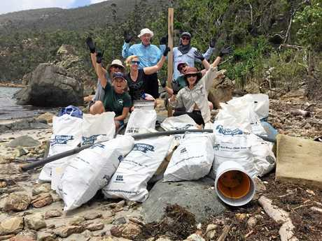 Eco Barge volunteers with a haul of marine debris collected in the Whitsunday region.