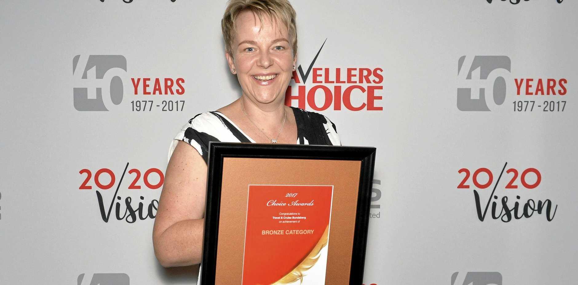 BRONZE CHOICE: Travel & Cruise Bundaberg manager Jenny Gregg accepts the award.
