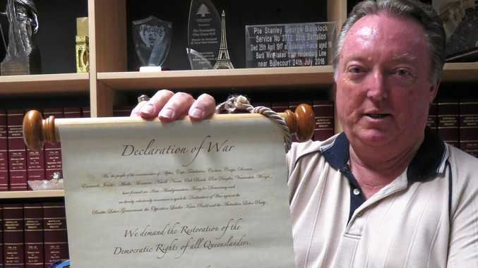TIME'S UP: Glen Elmes with only one of two copies of the 'declaration of war' scroll, designed for the Noosa de-amalgamation battle.