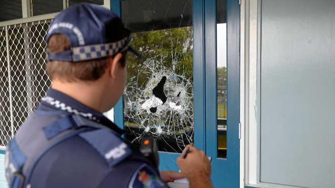 SCHOOL DAMAGE: Police investigate a break in at Central Bundaberg State School last year.