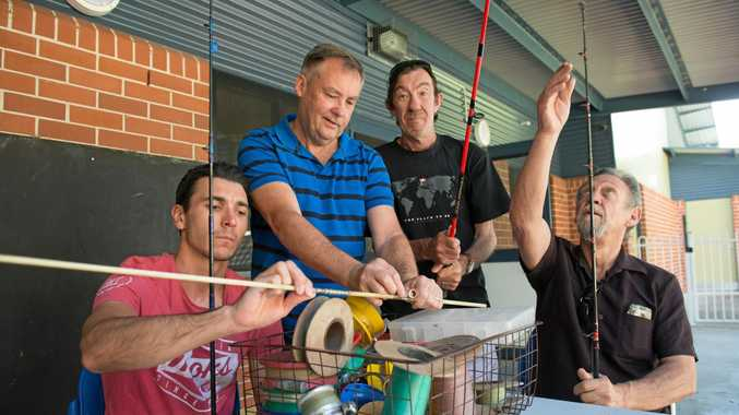 REEL GOOD: James Evans, John Crisp, Alex Pollitt and Phillip Barlow fix up and resell old fishing gear at the Fix It Fishin' men's group at the Boambee East Community Centre. Money raised goes towards fishing trips.
