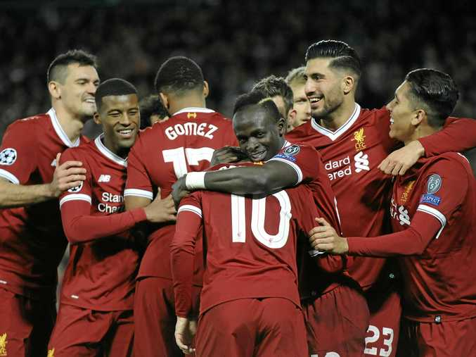 Philippe Coutinho is congratulated by teammates after scoring LIverpool's fifth goal against Spartak Moscow.