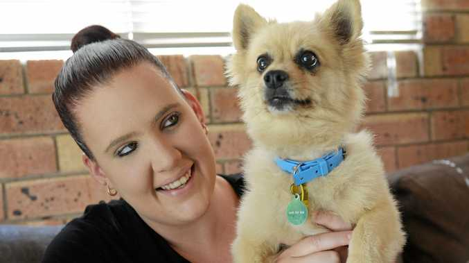 PASSION FOR PETS: Allanah Betts holds one of her rescue dogs, Lucky.