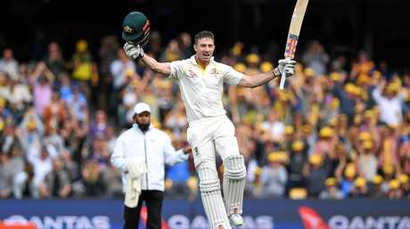 Shaun Marsh celebrates after scoring a century in the second Ashes Test in Adelaide.