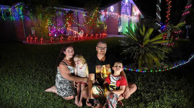 Kellie Campi with family Brent, Lincoln, 5, and Olivia, 2, in front of their Christmas display at 3 Whitehaven Dr, Buderim.
