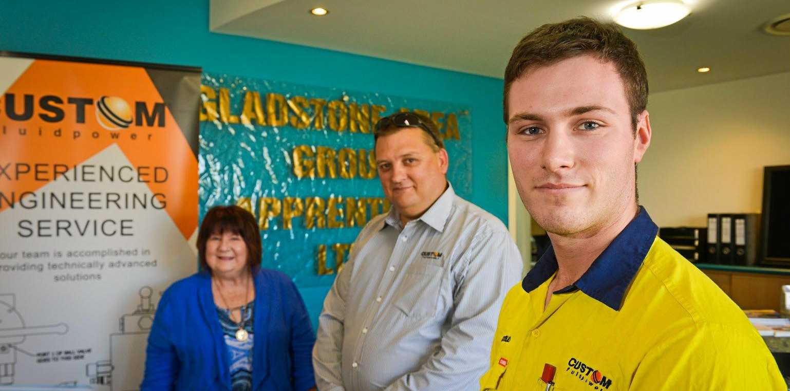 WIN WIN: Gladstone Area Group Apprentices CEO Leigh Zimmerlie welcomes Custom Fluid Power branch manager Grant Aitken and new apprentice Gerrard Bannan.