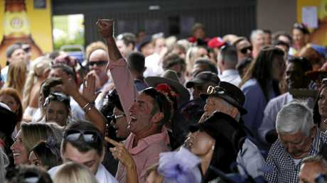 GREAT FUN: Gold Coast man Patrick Sutton celebrates a win as the crowd watches the Melbourne Cup wrap up on the big screen at the Tweed River Jockey Club.