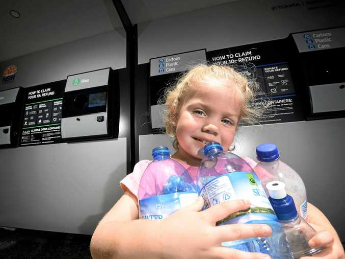 BRIGHT YOUNG THING: Layla Griffiths, 3, of Goonellabah, returns plastic bottles to Lismore's reverse vending machine in order to raise money for her piggy bank.