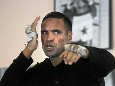Anthony Mundine shadow boxes in the gym.