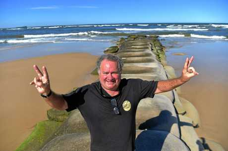Local residents celebrate the decision not to build a rock wall on the Maroochy River.Stuart Dell is happy about the decision.