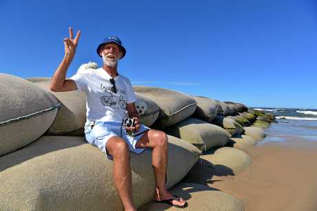 Local residents celebrate the decision not to build a rock wall on the Maroochy River.Glen Eglington is happy about the decision.
