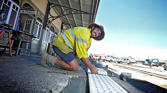CHUGGING ALONG: Tim Wyvill works to get the finishing touches done on the heritage station.